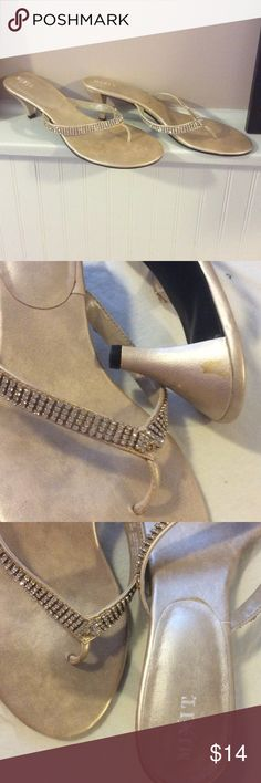 Champagne sandals with rhinestones Formal sandals with rhinestones. One has a stain on the heel/bottom as pictured. Worn in a wedding. They are an 11 but I think they fit better on a 10/10.5. If you have wide feet they can be a little tight Mixit Shoes