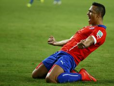 Chile's Alexis Sanchez celebrates after scoring a goal during their 2014 World Cup Group B soccer match against Australia at the Pantanal ar...