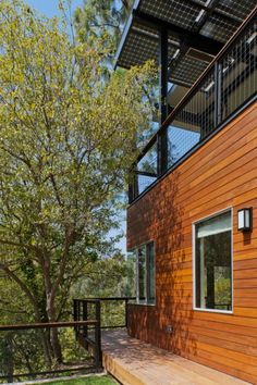 Modern Wooden House Surrounded By Shady Trees Make House Fresh modern broom way house design with Solid wood Home design http://seekayem.com