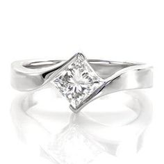 Princess Motion - Princess Motion is a contemporary statement with the fashion-forward contour of the the 14k white gold band. The 0.75 carat princess cut diamond is poised elegantly between the by-pass of the ring. A gentle twist of the band seamlessly showcases the brilliant center stone adding movement to the top of the ring.