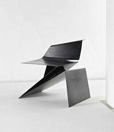 Origami Chair by Philip Michael Wolfson Examining the abstraction of penetration, folding, layering and juxtaposition, creating a collision of static versus dynamic forces.