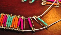 Safety Pin/Bead Bracelet  Instructional Video at: http://www.gurl.com/videos/do-it-yourself-crafts-for-girls/make-a-safety-pin-bracelet/