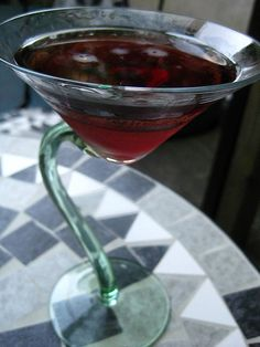 Black Dahlia Martini -   3 1/2 oz  vanilla vodka   1/4 oz  black raspberry liqueur   1/4 oz  coffee liqueur   1  orange