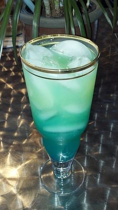 BLUE HAWAIIAN COCKTAIL   * 3/4 oz. Light Rum * 3/4 oz. Vodka * 1/2 oz. Blue Caracao * 3 oz. Pineapple Juice * 1 oz. Sweet & Sour Mix