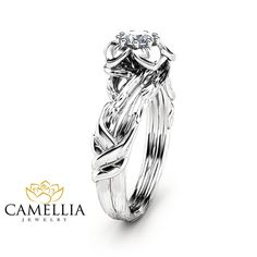 Start your happily ever after off on the right note with this natural diamond flower engagement ring from Camellia Jewelry. This unique design