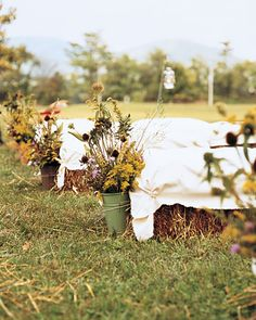 hay bale wedding ceremony seating with wildflowers Hay Bale Seating, Ceremony Seating, Outdoor Wedding Seating, Rustic Outdoor, Outdoor Ceremony, Farm Wedding, Wedding Ceremony, Rustic Wedding, Field Wedding