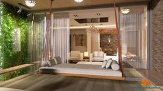 Living room furnished with lovely ceiling hung  swinging element  with pillows and bolsters .Space creating a cozy ambiance with planter wall and wooden bench sitting .