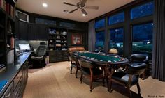Mix business and pleasure all in one room. This man cave doubles as an office and a poker room for the guys. How fun is that?
