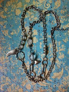 Clear glass beads on silver chain/ with add on charms. FB page Leave it at the Cross3:16