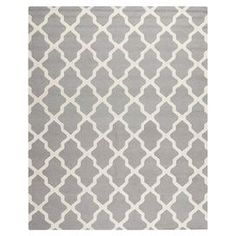 Hand-tufted wool rug with a Moroccan tile motif in silver.  Product: RugConstruction Material: WoolColor: Silver and ivoryFeatures:  Made in IndiaHand-tufted Dimensions: 8' x 10'Note: Please be aware that actual colors may vary from those shown on your screen. Accent rugs may also not show the entire pattern that the corresponding area rugs have.Cleaning and Care: Professional cleaning recommended