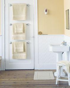 Towel rods on the back of the bathroom door...