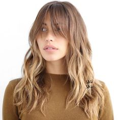 Long Layered Hairstyle With Long Bangs