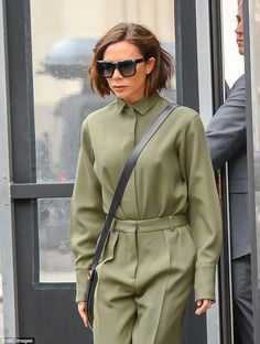 The former Spice Girl, 43, was the picture of sophistication in a khaki utility jumpsuit and leather stiletto boots, as she left the Edition Hotel and headed out into the city.