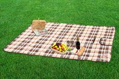 Picnic Mat Brown Checks    Made of Polar fleece cloth with a durable water repellent sheet at the bottom, this picnic mat is ideal for all outdoor activities. Velcro closure and convenient canvas carrying strap make our picnic mats compact and thus highly suitable for traveling purposes.