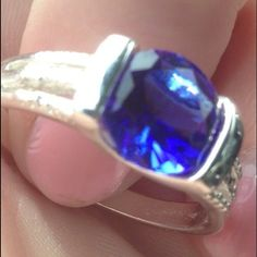 % 925 Sterling Silver Tanzanite size 8 ring  Brilliant Royal Blue, 1 carat % Tanzanite gem stone, flat top, diamond cut in an % Sterling Silver setting  Gorgeous ring size 8.. NWOT  Jewelry Rings