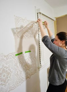 Here's a quick snap of Young House Love author Sherry Petersik using our ever-so-versatile Lisboa Tile stencil. There are several Royal Design Studio stencil tutorials in the book!
