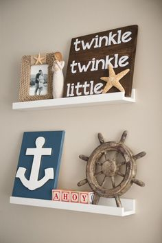 Adorable nautical nursery decorations! These would look great with Liz and Roo's navy anchors bedding.