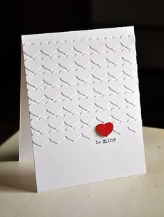 """By Maile Belles. Partial emboss front of white card base using Stampin' Up/Sizzix """"Happy Heart"""" embossing folder. Dry emboss scrap of red with same folder, cut out one heart, and attach over a white heart. Add sentiment."""
