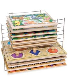 Melissa & Doug Deluxe Wire Puzzle Rack A puzzle rack to solve your storage puzzle! This sturdy wire rack holds up to six large and six small puzzles for convenient cleanup and organization. What You Get Wire puzzle rack Puzzle Organization, Puzzle Storage, Toy Storage, Playroom Storage, Storage Ideas, Storage Solutions, Kids Storage, Organization Ideas, Storage Units