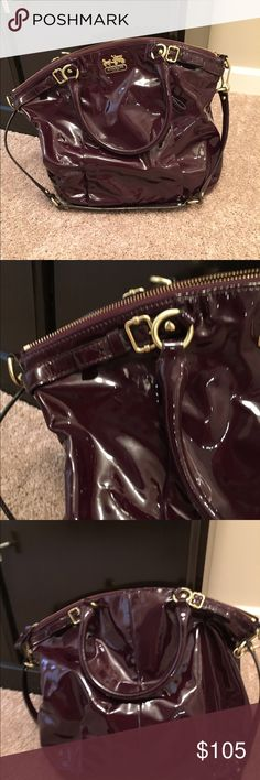 Absolutely gorgeous Coach handbag in Aubergine. Rare and hard to find COACH Madison large patent leather handbag. There are Pen marks inside the bag. There are scuff marks on the outside as well. Coach Bags Totes