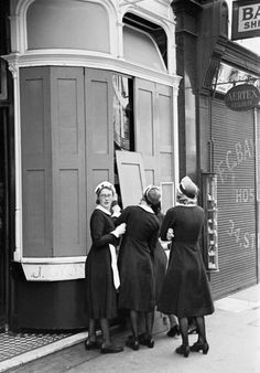 "WW II London Blitz- Lyons Corner House waitresses, called ""nippies""."