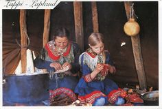 Lappland women sewing reindeer hide and decorations