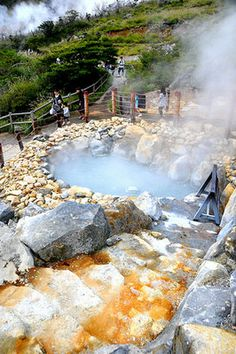 Owakudani (Japan) meaning the Great Boiling Valley, is located in the mountain town of Hakone. One can take an aerial tram up to the hot springs,Once the springs are reached, kuro-tamago, or black eggs, can be purchased five at a time. The eggs are ordinary chicken eggs but the shell turns black due to being boiled in the hot sulfur spring. Local tradition holds that for each black egg eaten, seven years is added to one's life.