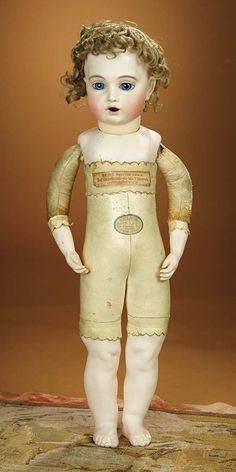 """Rare French Bisque """"Bebe Gourmand"""" by Leon Casimir Bru with Original Bru Shoes ~~~ firmly-stuffed kid bebe body with kid-over-wood upper arms, bisque forearms with separately sculpted fingers, bisque lower legs from the knees, bisque bare feet sculpted with hole at bottom for food to fall through trap-door shoes."""
