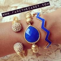 Gold toned bead bracelet with deep blue gem matched with our adorable blue zig zag bracelet and gold cuff! Great accessories to match with other arm candy!