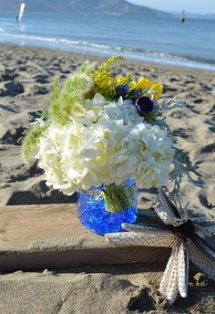 Don't you love the cottage-y blue glass vase? These flowers are beachy blue and fresh as the breezes off the Pacific. A #RossiandRovetti exclusive. Blue Horizon #Floral Arrangement. #San Francisco's beloved flower boutique