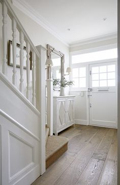 A 5 bedroom semi-detached edwardian house in wandsworth. Substantially extended and decorated in bright whites throughout. E overall feel is a conte 1930s House Renovation, 1930s House Interior, Victorian House Interiors, Edwardian House, 1930s House Decor, 1930s Semi Detached House, White Hallway, Bright Hallway, House Staircase