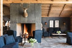 This hotel is a dream place for winter lovers #interior #design #home #decor #cozy #idea #Inspiration #style #room #fireplace #arm #chairs #blue #fire #living