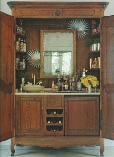 """Bryan Batt, of Mad Men, is also a designer. He repurposed his armoire and made it into a full wet bar.  Or a """"barmoire"""" as they were calling it on the Nate Berkus Show."""