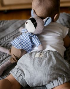 Cute baby style with Billie Blooms striped organic bloomers and Hazel Village raccoon doll. Adorable!