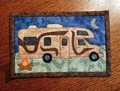INSTANT DOWNLOAD    PDF Pattern to make this camping themed mug rug or camper mini quilt. Made with these cute appliques. Measures 6 1/2 x 10    You can use them for setting your mug on with a snack, or my favorite way, leaning them against the wall in my hutch. You can even stitch rings to the back and hang on your wall.    These are the funnest of things to make! If you choose the machine applique, you can whip these up in no time. They make great gifts when given with a cute mug. They...