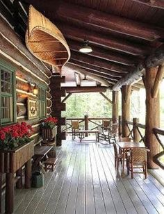 The perfect wraparound porch for a log cabin. Bonus: find a vintage birch canoe to hang!  :-)