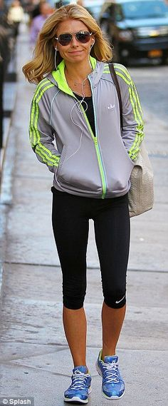 Spring in her step: Kelly beamed as she made her way to the gym in New York on Wednesday