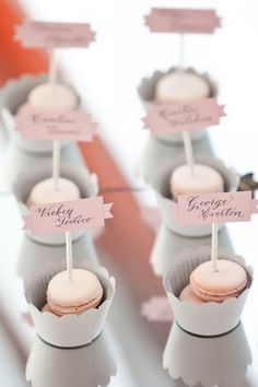 Cute way to display place cards! Macarons!