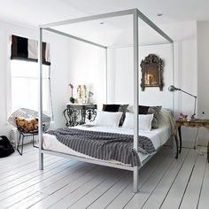 black white grey bedroom with painted floors