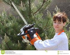 A Pretty Woman Holding A Chainsaw Stock Images - Image: 14301404