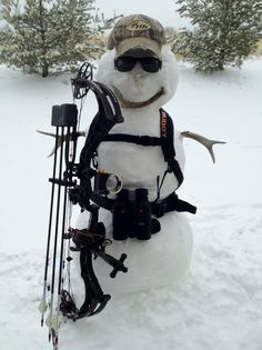 Frosty got all excited about getting back to the old way and hunting with a bow and arrow, but when it came right down to it, he found he couldn't do that to his little buddies in the forest. Guess he'll have to stick with competitions at the range.