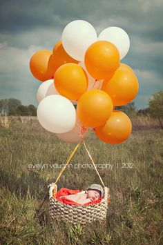 newborn ideas--replace the balloons with red & blue! Hotty Toddy :)