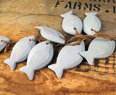 Eight wooden fish for the bathroom