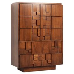 Lane furniture brutalist chest fo drawers in solid walnut  United States  1970's  Very nice cubistic chest of drawers produced by Lane Furniture Co., Altavista, United States. This one comes from the 'Mosaic' Collection.    This high console contains 5 drawers hidden behind a nicely designed solid walnut mosaic pattern.