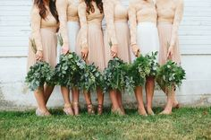 Bridesmaids in neutral chiffon skirts with greenery bouquets