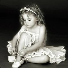 SHIRLEY TEMPLE PUTTING ON HER LITTLE BALLET SHOES.....THIS LITTLE CHILD  BROUGHT A WHOLE MOVIE STUDIO OUT OF BANKRUPTCY.......ccp.