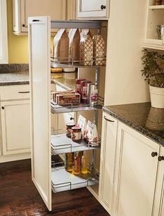 TLM: I don't love this type of cabinet because it seems like it would be oriented to one side or the other. Inconvenient if you're standing on the wrong side of the cabinet when you open it! One solution is to use lazy susans on all shelves to ensure items are accessable from both sides of cabinet. space saving storage solutions for modern kitchen