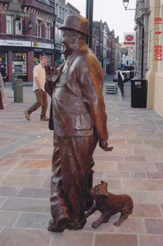 Bronze Playground Art Fantasy or Cartoon statue by artist Graham Ibbeson titled: 'Laurel and Hardy (bronze life size Film Star sculpture/statue)'