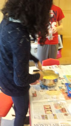Our teens at work making vanilla pudding pies.