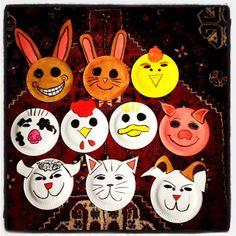 Children's farm animal masks made of paper plates.